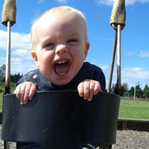 He was having fun on the swing at the playground just across the street from the new house!